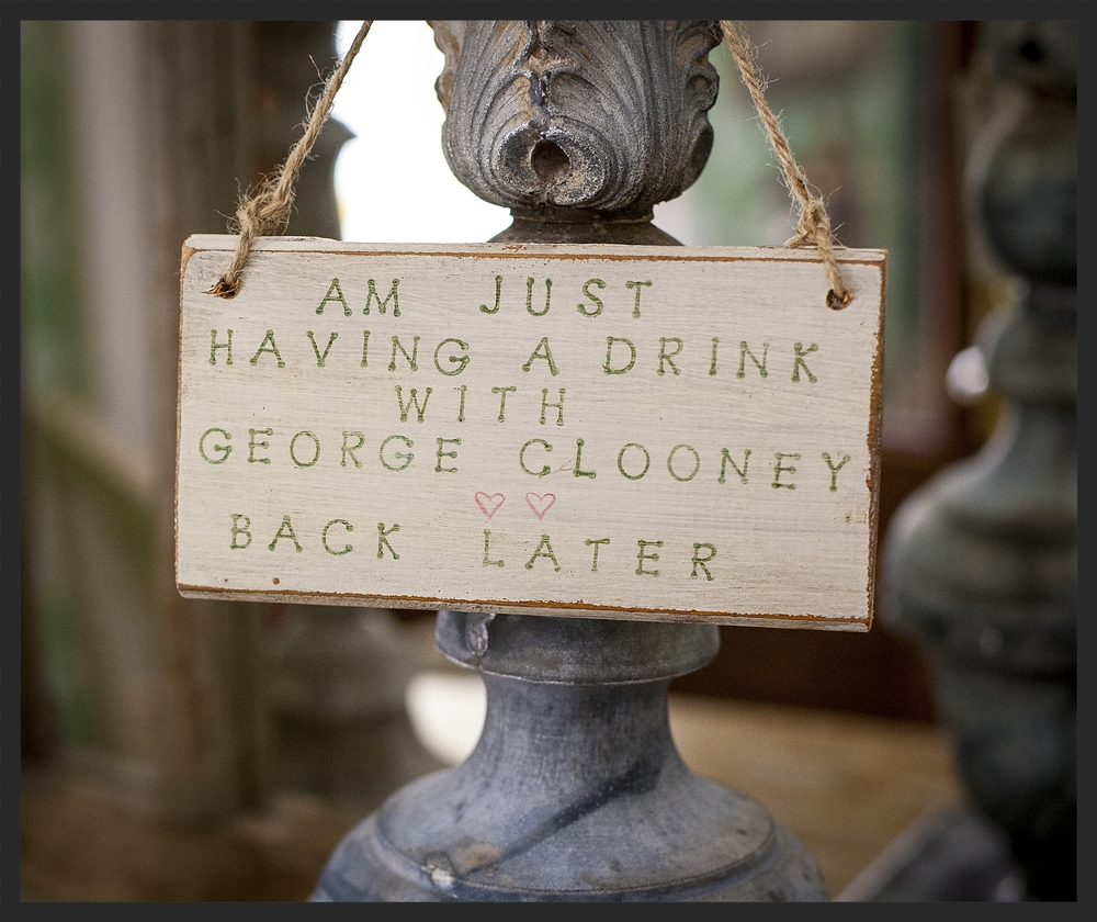 Fun door hanger resting in zinc weather vane.  Linda Kay McCloy - alittleenglishinteriors.com