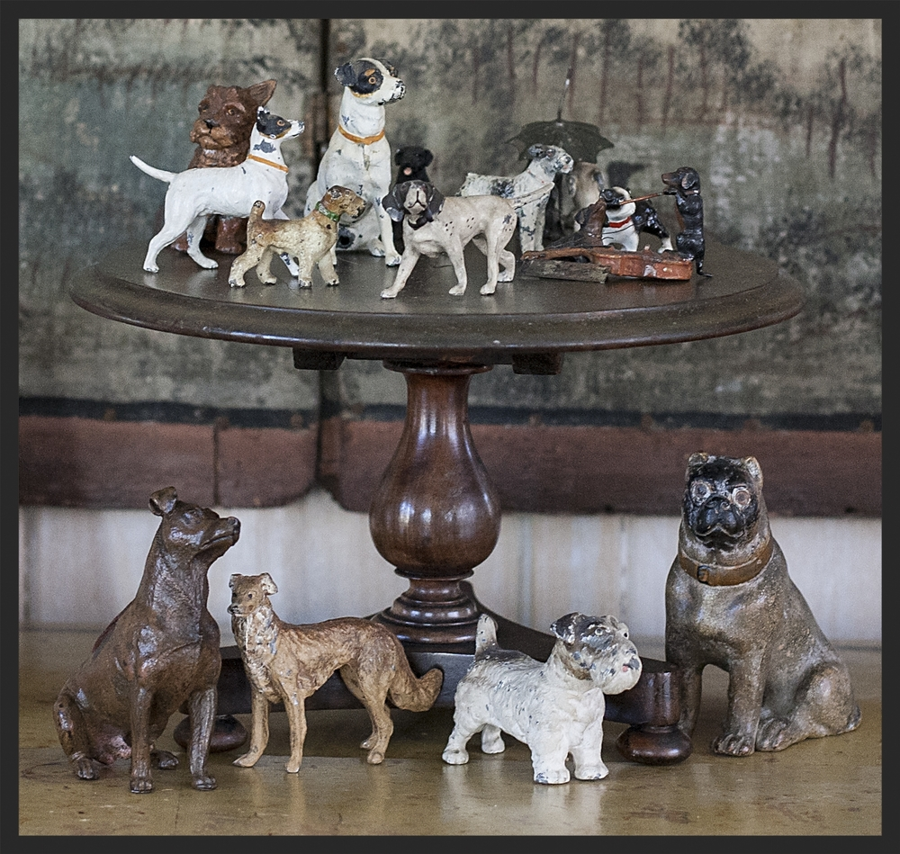 Various bronze and iron dogs on English mahogany salesman's sample table.  Linda Kay McCloy - alittleenglishinteriors.com
