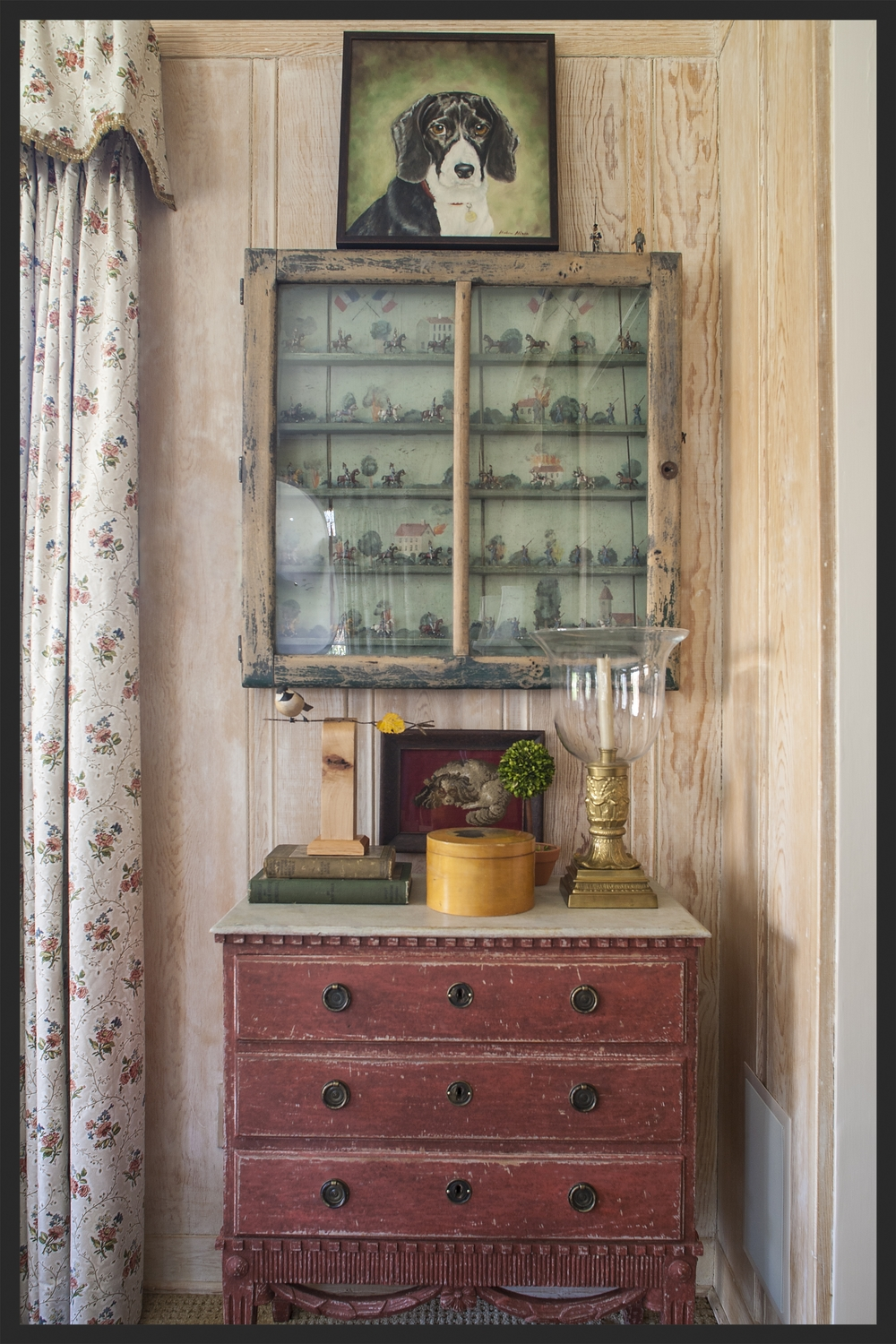 Toy soldiers housed in a painted cabinet.  They hang over a  painted Swedish chest.  Linda Kay McCloy - alittleenglishinteriors.com