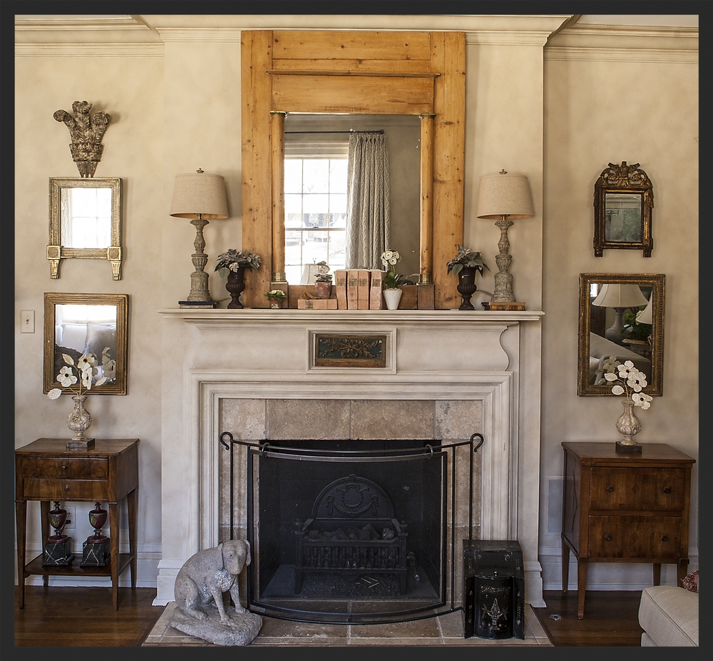 Various English and French mirrors surround the mantle.  Linda Kay McCloy - alittleenglishinteriors.com