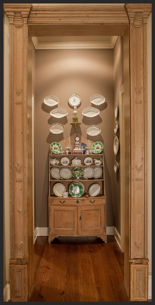 View through English pine door surround of a creamware collection.  Linda Kay McCloy - alittleenglishinteriors.com