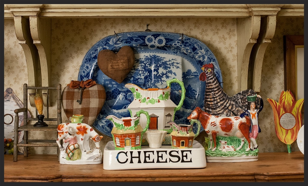 Collection of English children's plates and jugs.  Birdhouse, tulip, and chicken frames by John Derian.  Linda Kay McCloy - alittleenglishinteriors.com
