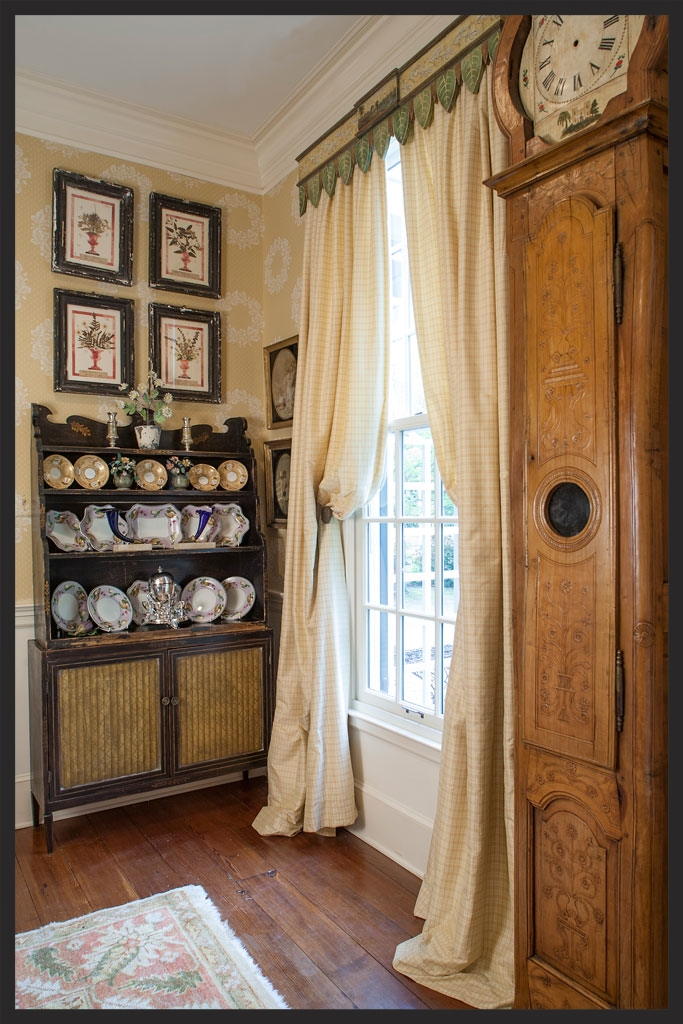 Corner of dining room.   Painted English regency bookshelf with Wedgwood dessert service.  Drapery cornice painted by Richard Martin.  French clock.  Linda Kay McCloy - alittleenglishinteriors.com