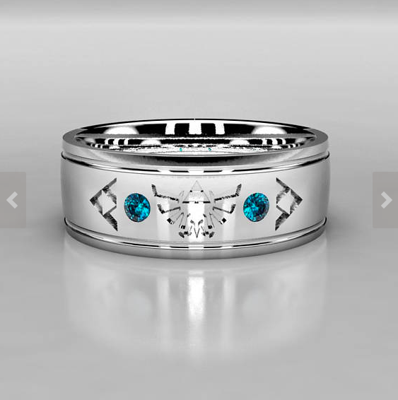Legend Of Zelda Wedding Band Inspired by the hit video game classic. Available with different gemstones. Above with Blue Diamonds in Palladium White Gold.