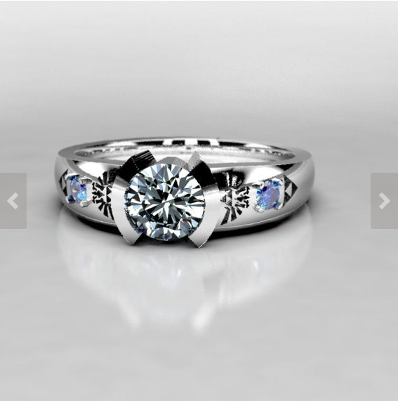 Legend of Zelda Inspired Engagement Ring With Moissanite Center Stone, and Lab Created Sapphire Accent Stones in 10k White Gold.