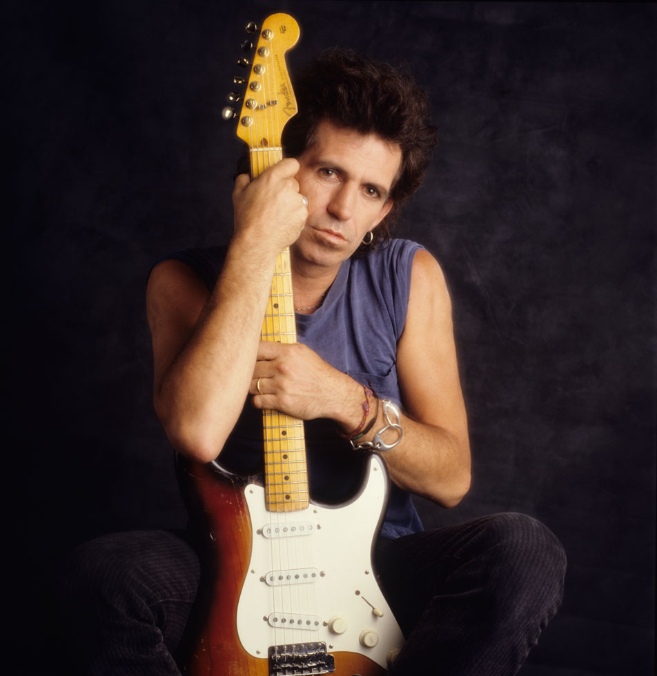 Rolling Stones Keith Richards holding guitar 1988