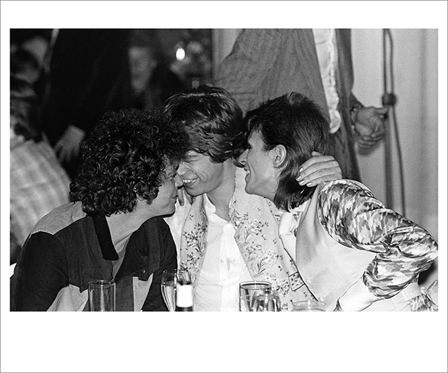 Lou Reed, Mick Jagger and David Bowie Cuddling at Cafe Royal, London 1973