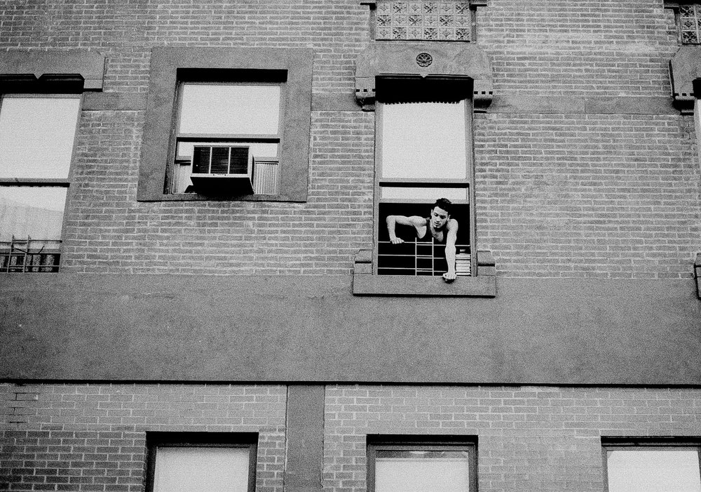 Man Looking Out Window- Spanish Harlem