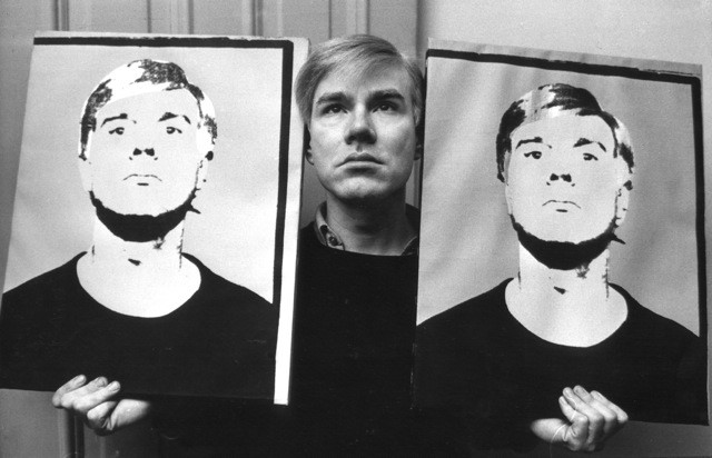 Andy Warhol with Portraits, 1964