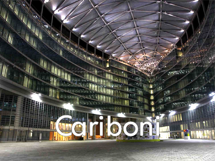 Cariboni Group - Cariboni group, born in 1908 and leader in the public illumination and functional urban design field, is composed by Cariboni Lite e Fivep (and, in addition to them, their foreign branches: Cariboni France, Cariboni Iberica, Cariboni Illuiminacao and, since 2003, T.I.L.C in Tunisie). All the group's companies are specialised in the production and commercialisation of illumination fixtures.Cariboni Lite, Cariboni Illuminazione until 2003, is born at the beginning of the Seventies, after the incorporation and the transformation of F.I.R. FABBRICA ITALIANA RIFLETTORI GARIBOLDI. A flexible and efficient work group with an own engineering structure, for a company that normally co-operates with the most famous marks of the lighting industry. FIVEP takes its origin in the fusion of three great leading companies: FIDENZA VETRARIA, POLLICE ILLUMINAZIONE, SOLDI & SCATI. The merger of these three great conceptions, together with the will to continue the work launched years ago, guarantees today a leading position in the public lighting market.The decal presence of Cariboni Group on illumination market enabled the society to develop competence and know-how, which brought the firm to a leader position, as far as the production of ad hoc illuminating solutions is concerned. The wide range of products specially designed for residential, architectural or functional lighting, offers a large choice to any professional designer who uses artificial light to give life and a special shape to any space, all this by complying with actual norms.