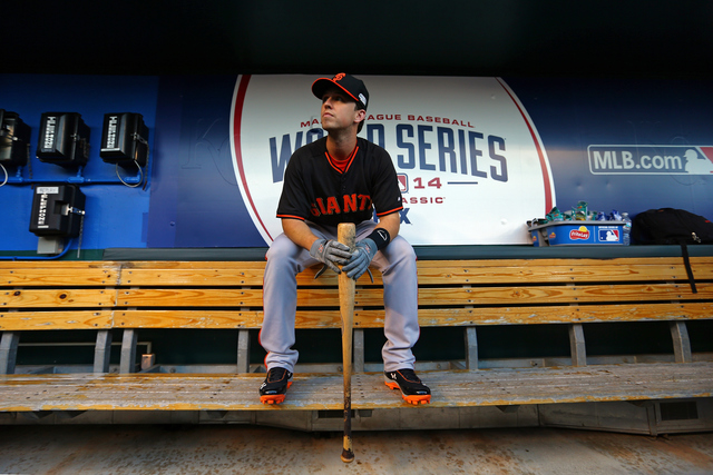 Buster Posey in the dugout during the 2014 World Series (Source: kshb.com)