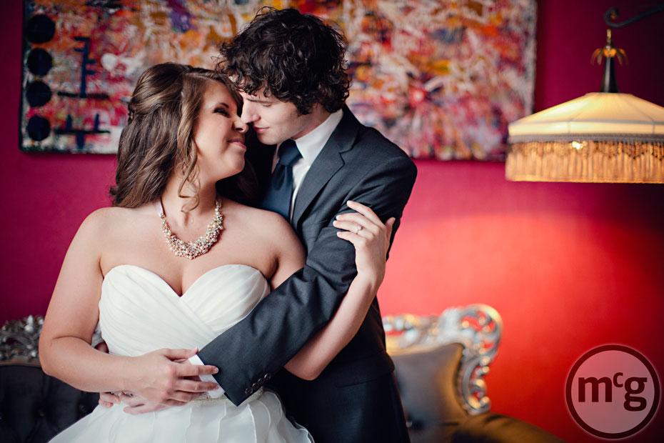 Bride & Groom portrait red wall NYLO Dallas South Side