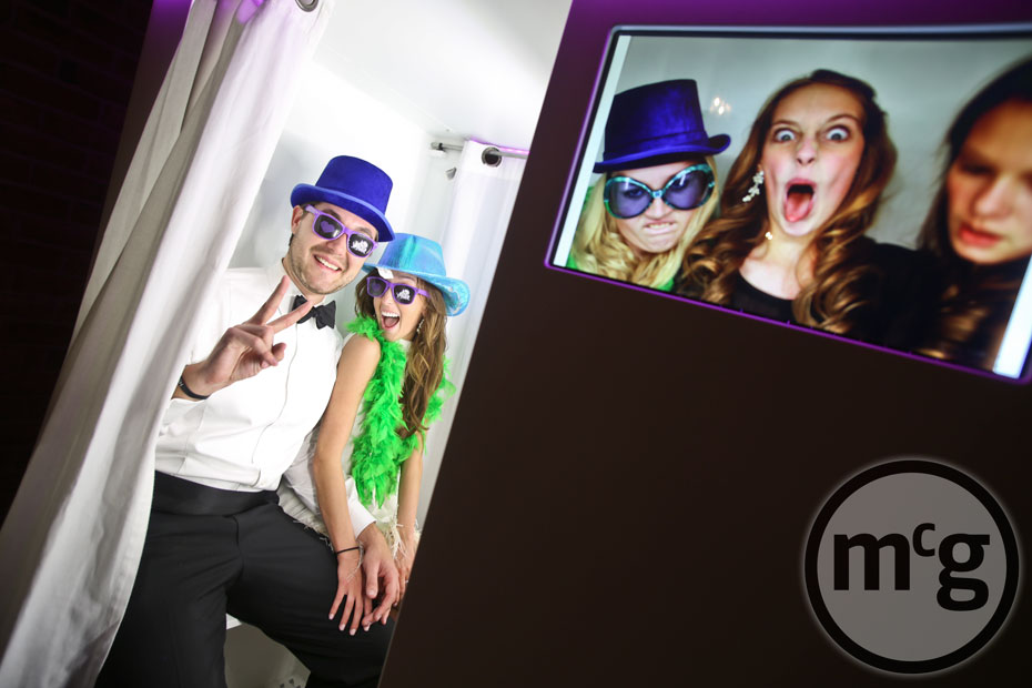 Bride & Groom in Photobooth with props