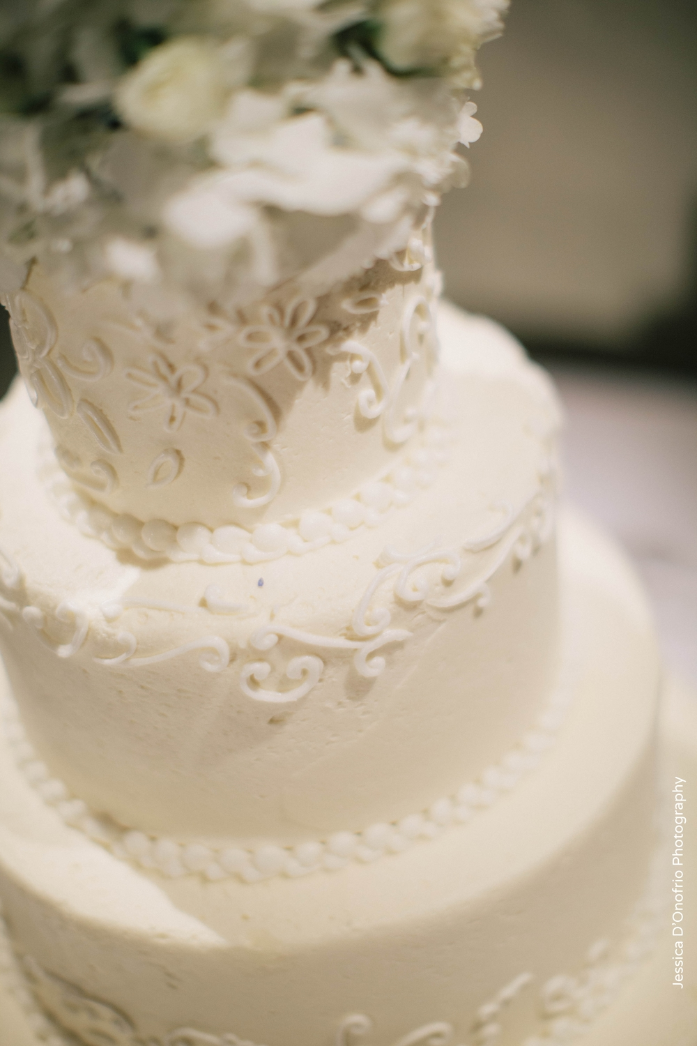 White Wedding Cake Floral Accent Panini Bakery
