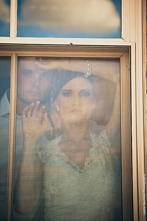 Bride & Groom Looking out Window