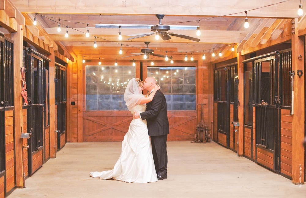 Bride & Groom in Barn Classic Oaks Ranch