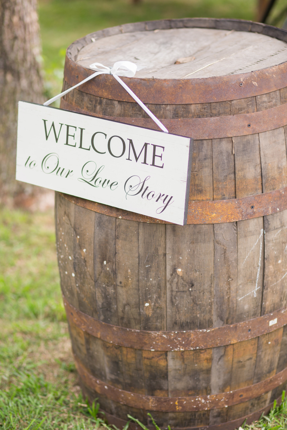 Welcome to our love story sign on barrel