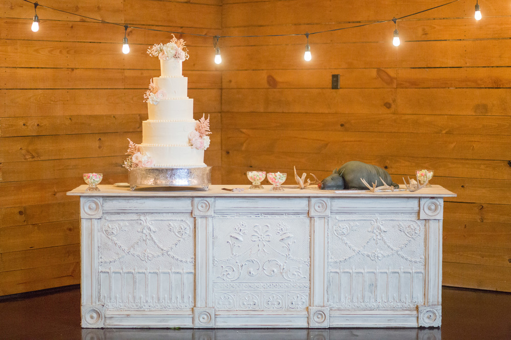 Wedding cake and groom's cake on white bar cafe lights