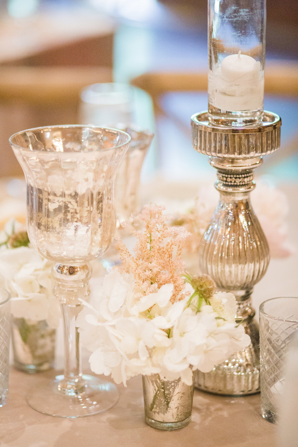 Mercury glass candle white floral wedding tablescape