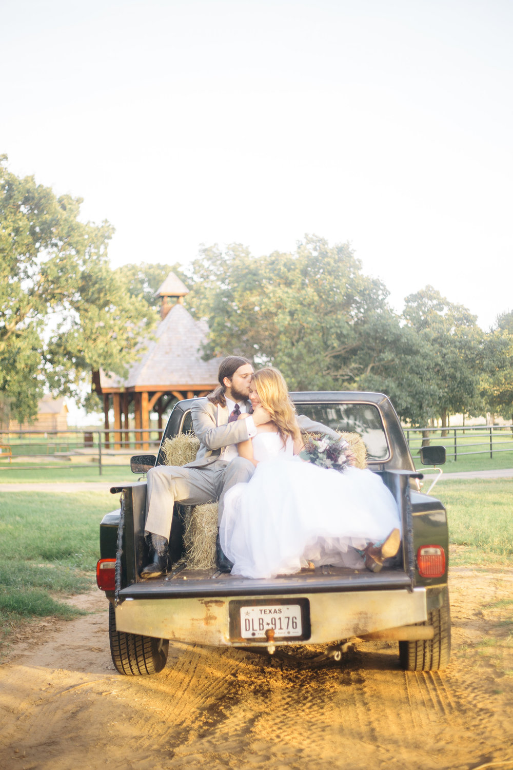 Bride & Groom In back of Old Truck