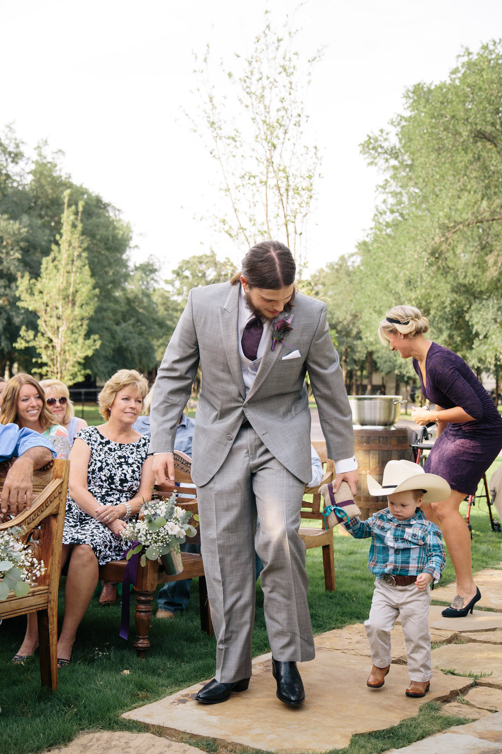 Groom and cowboy ring bearer