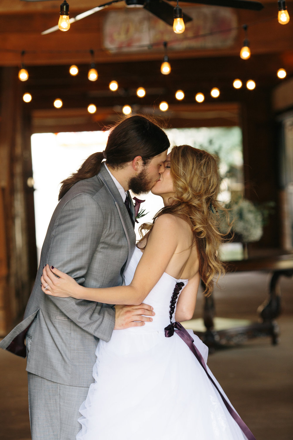 Bride & Groom Kissing in Barn