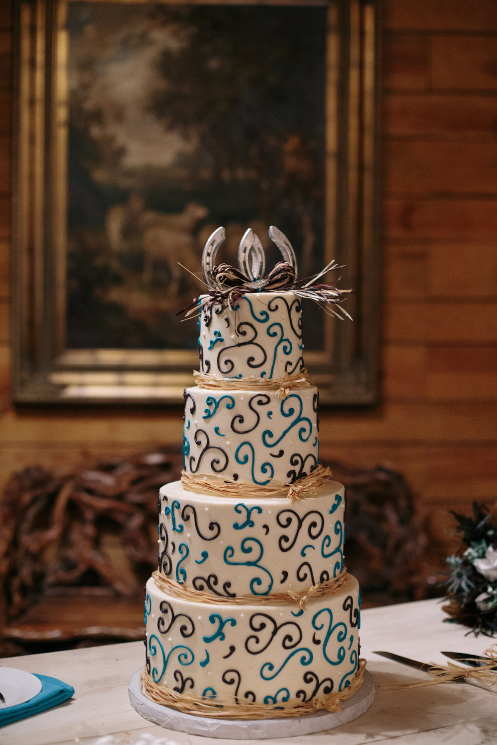Equestrian Horseshoe purple teal wedding cake