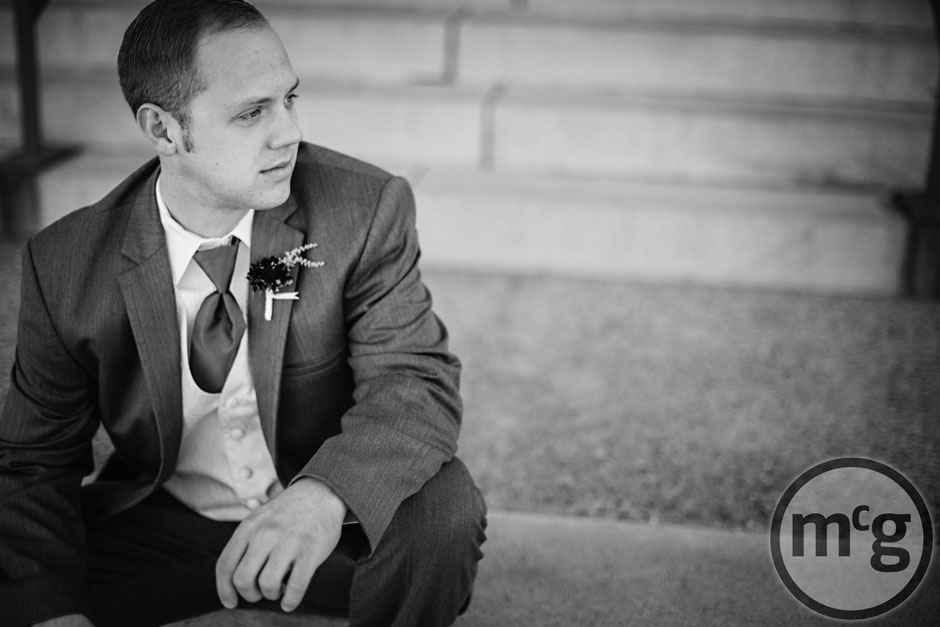 Groom on steps black and white