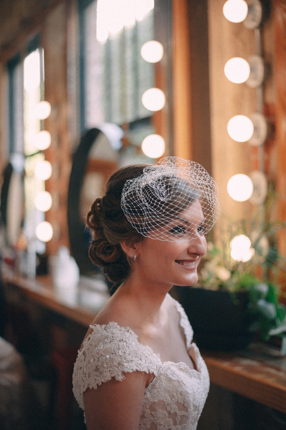 Bride Updo Birdcage Veil Hollywood Lights