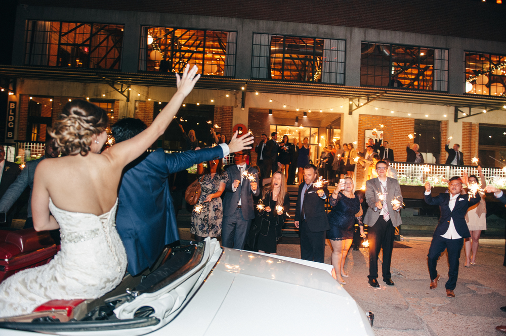 Bride & Groom in Getaway Car Wedding Sparkler Grand Exit