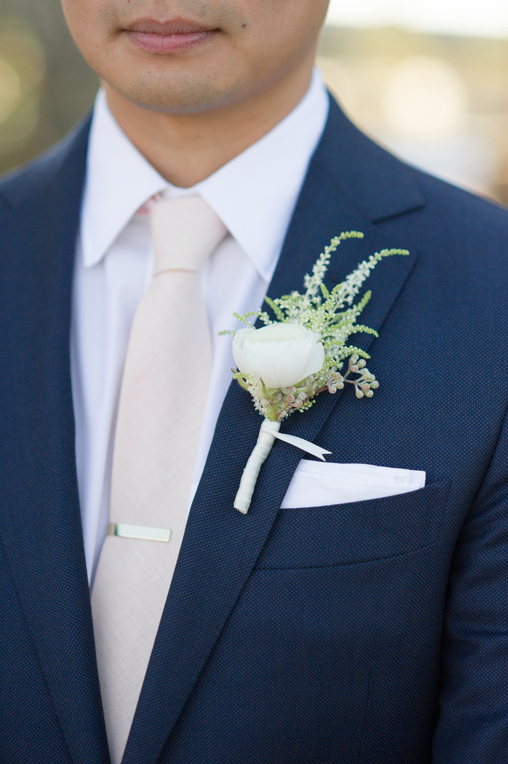 Groom White Rose Boutonnierre Navy Suit Tan Tie