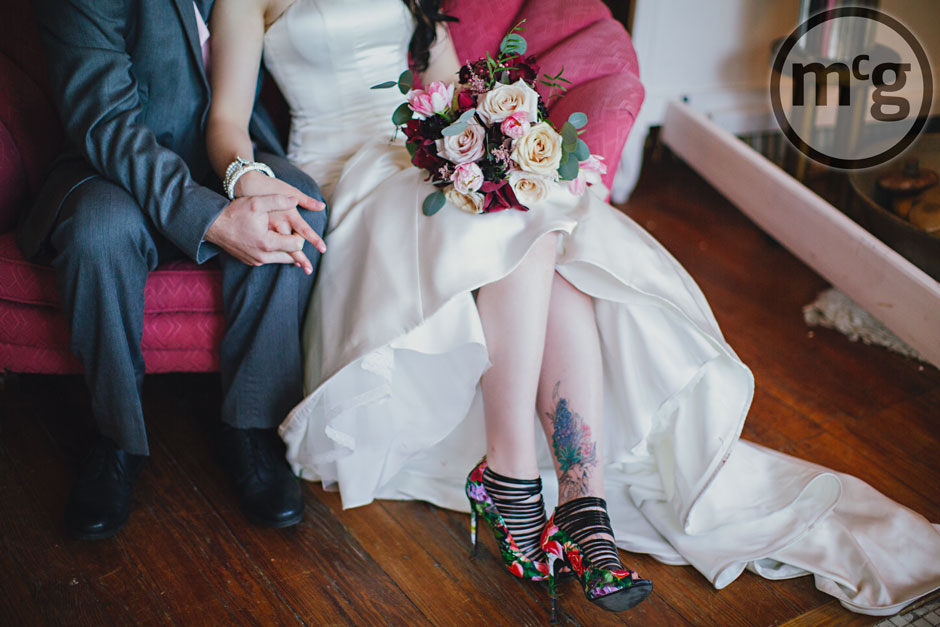 Bride showing off floral red stillettos