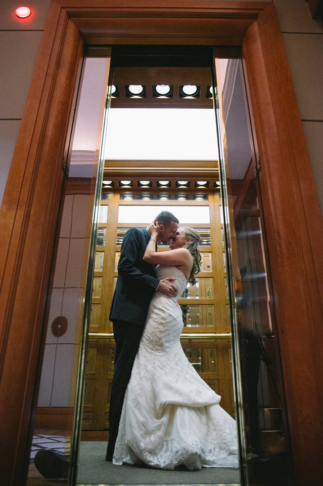 Bride & Groom Kissing in Cityplace Elevator