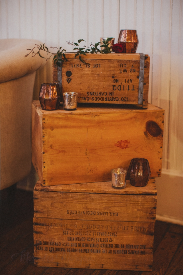 Stack of wooden crates wedding vignette