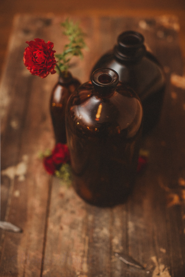 Amber bottles red flowers marsala