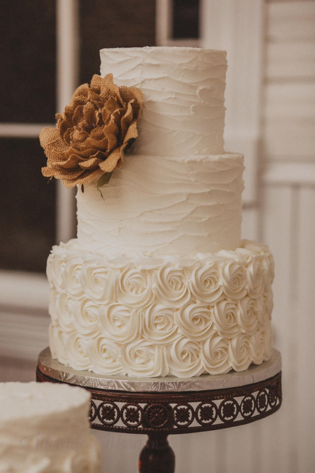 Burlap flower messy buttercream wedding cake