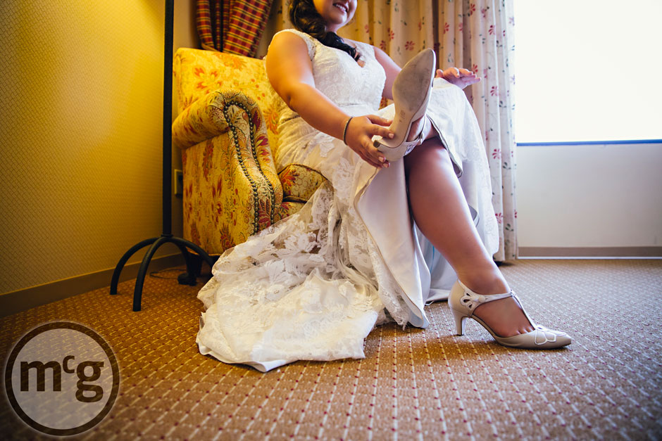 Renaissance Worthington bride putting on shoes