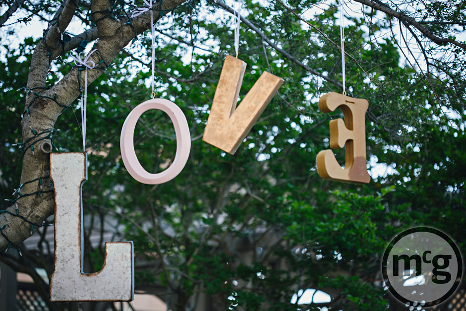 Wedding Love Sign Hanging from Trees