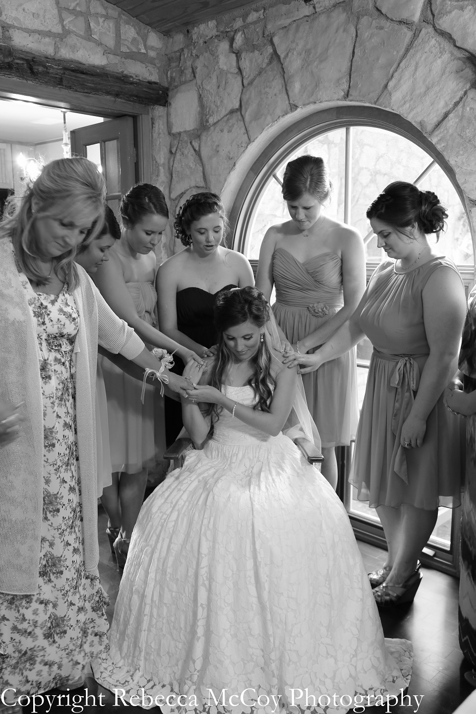 Bridal Party Praying over Bride