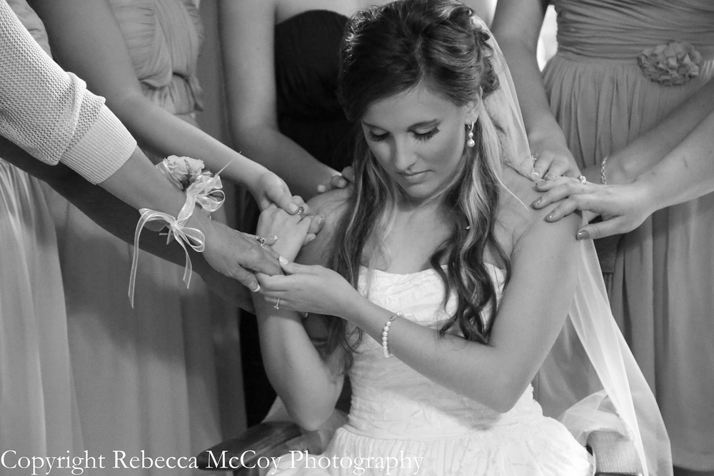 Bride Praying on her wedding day