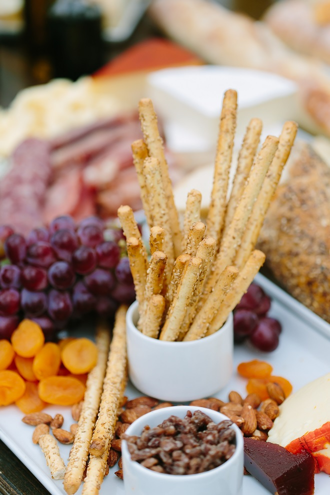 Crackers, dried fruit, breadsticks wedding charcuterie display