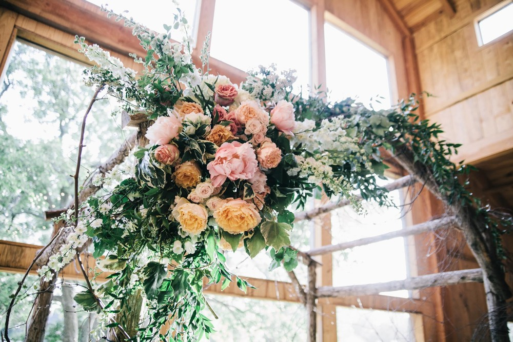 Peach orange greenery organic wedding arch