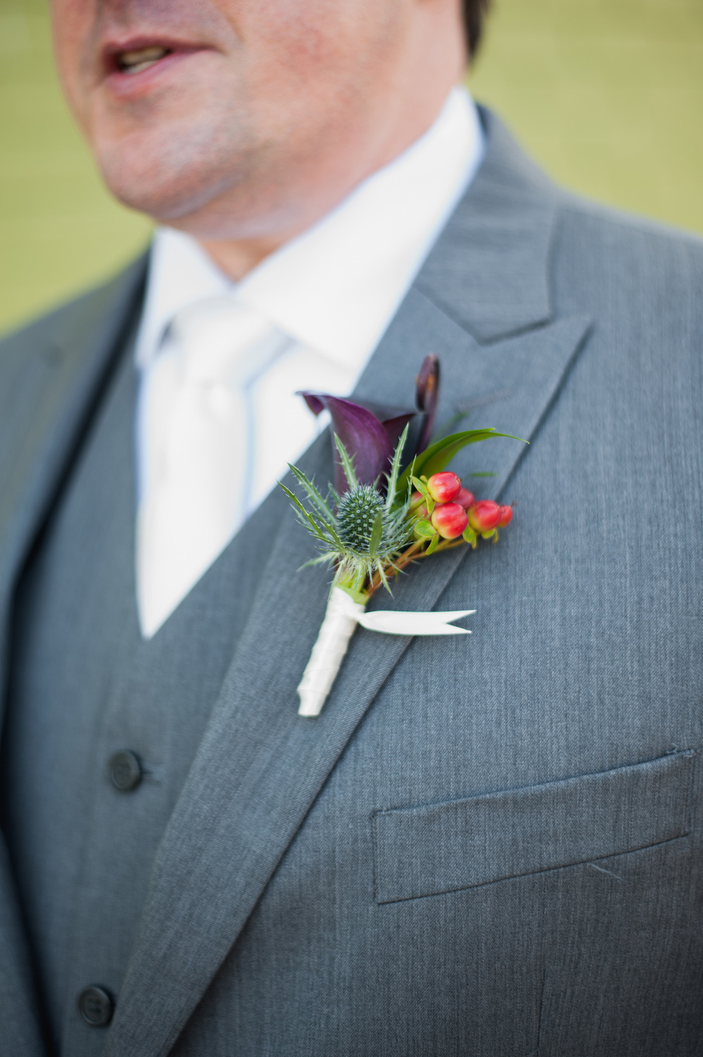 Groom's boutonierre fall wedding calla lily scabiosa berries