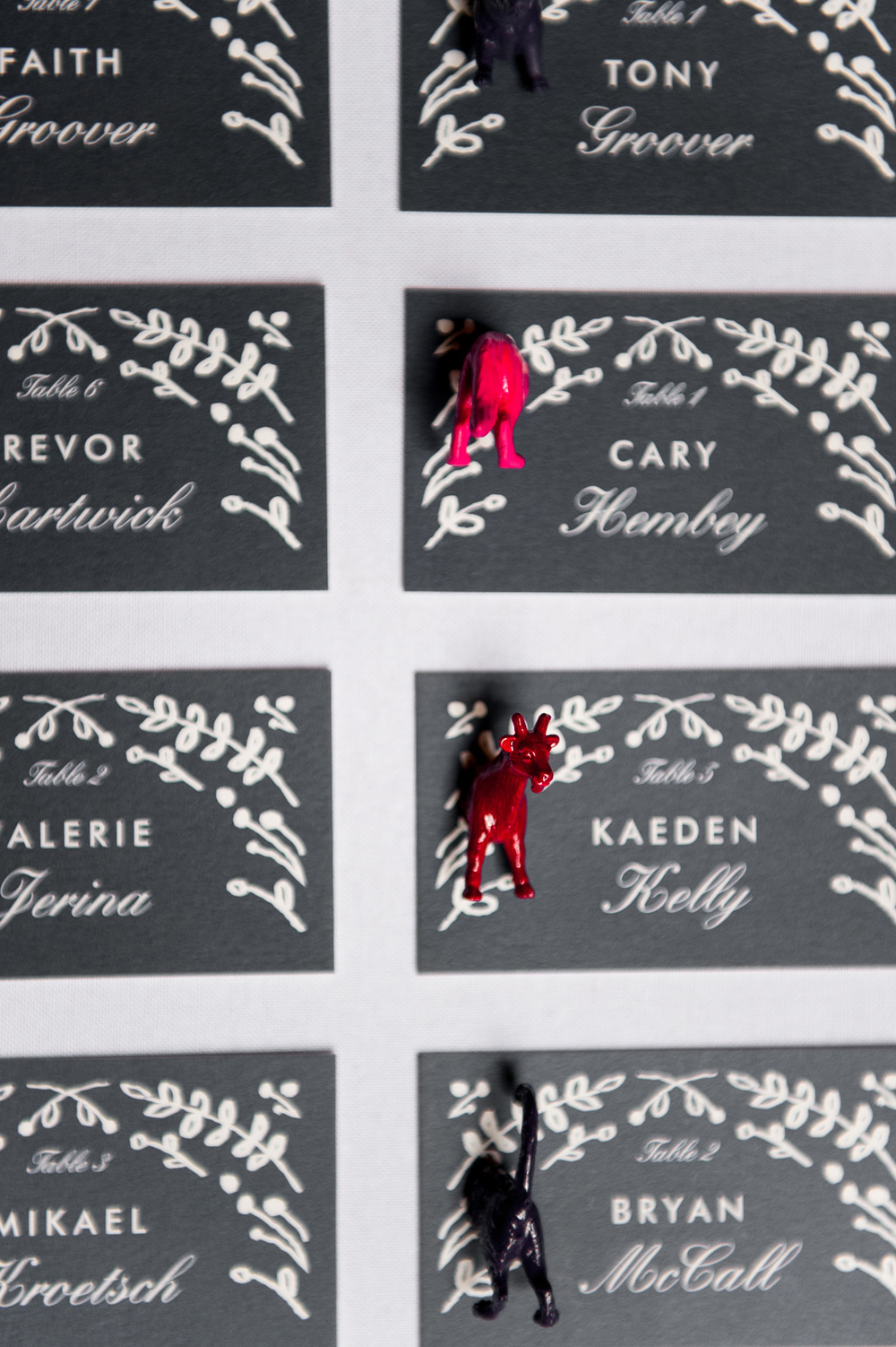 Navy leaf escort card display animal magnets wedding closeup