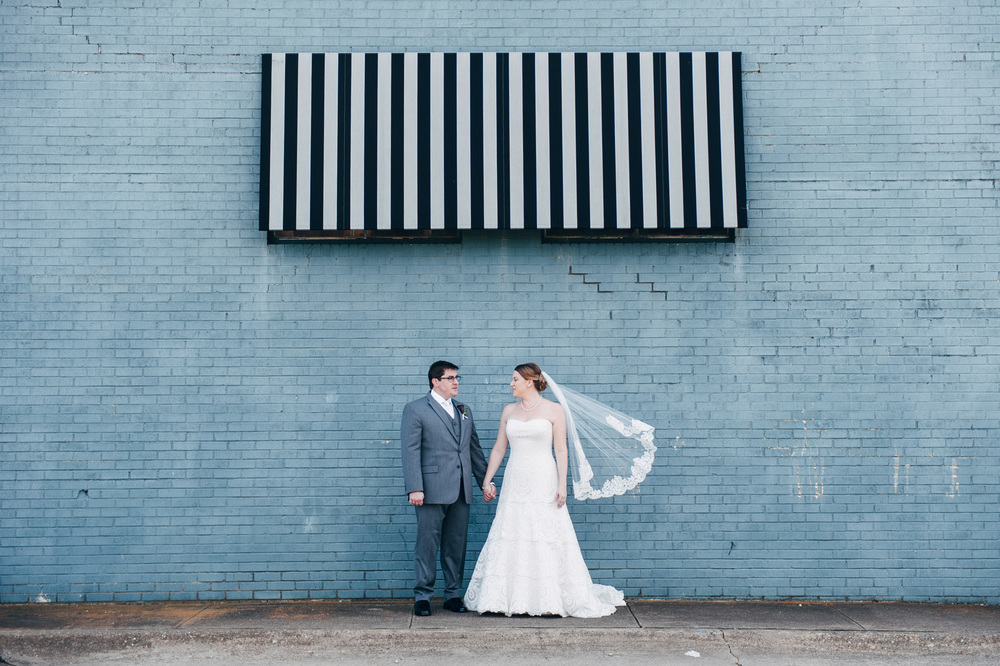 Bride & Groom blue wall