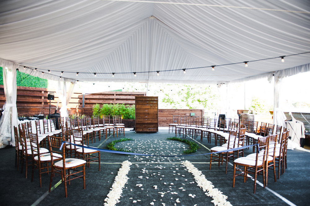 Circular wedding ceremony setup under tent