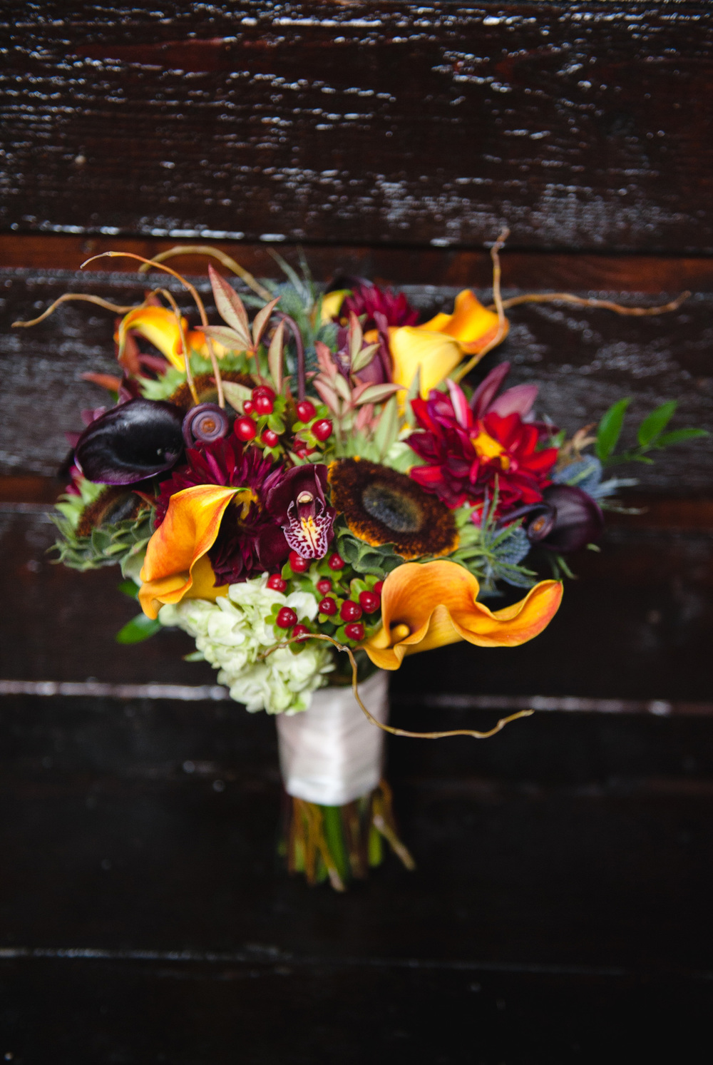 Fall bridal bouquet berries calla lilies green sunflower orchid