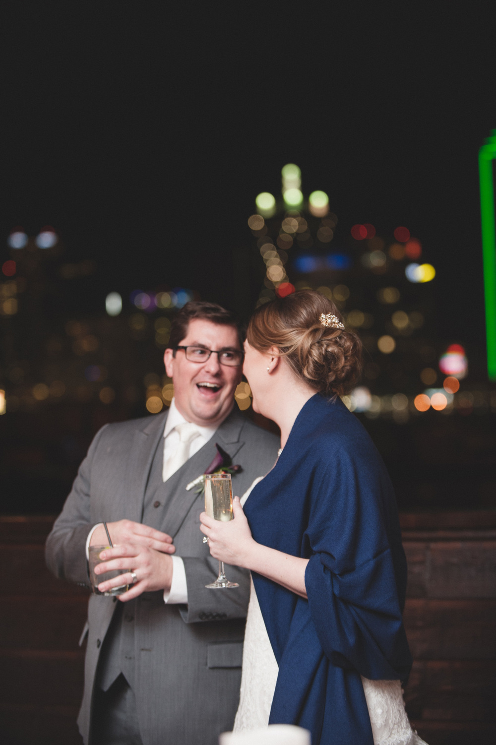 Bride & groom laughing Dallas skyline