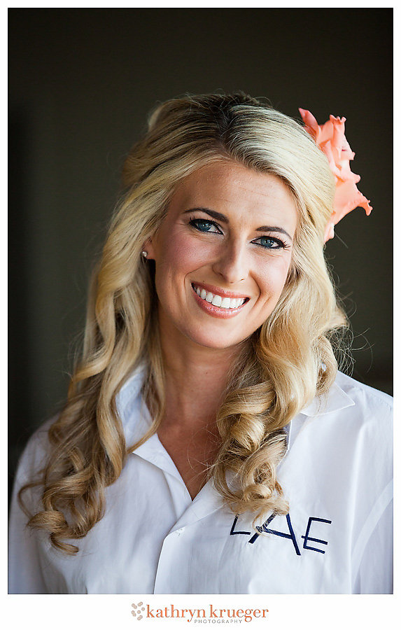 Half-updo bride hairstyle flower in hair monogrammed shirt