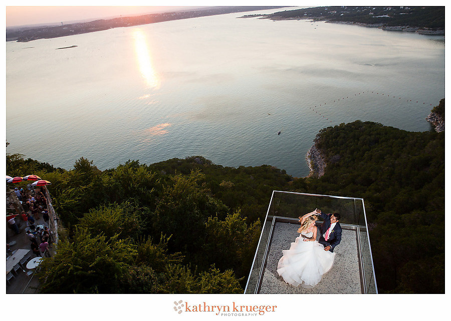 Bride and groom dancing over Lake Travis